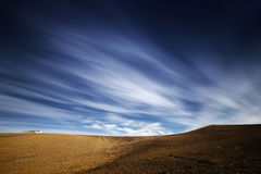 Crop field with moving clouds Royalty Free Stock Photo