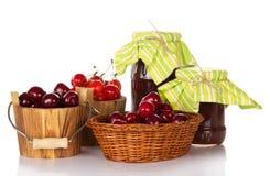 Crop of fresh sweet cherries and jam Stock Photography