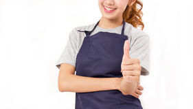 Crop Image Of Asian Woman Wearing Apron Showing Thumbs up. Royalty Free Stock Image
