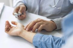 Crop image of doctor take the pulse of patient stock image