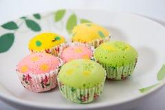 Crop image  of poka - dot cup cake on a plate with beef curry. Cup cake with colorful dot on a plate Stock Photos