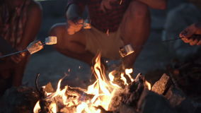 Crop people grilling marshmallows in fire stock footage