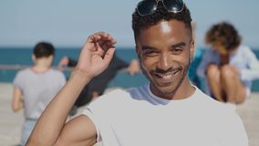 Smiling young ethnic man in sunshine stock footage