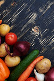 Crop shot of vegetables lying on the wooden table. Overhead crop shot of vegetables lying on the wooden table. Fresh and raw ingredients for preparing a healthy Royalty Free Stock Photography