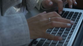 Crop shot of woman using laptop stock footage