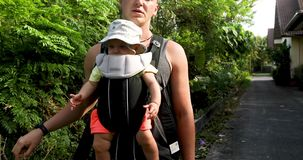 Crop man with baby in carrier stock footage