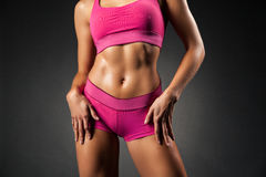Crop sportive female posing seductively Stock Photo