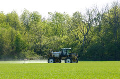 Crop Sprayer. Spraying pesticide on a winter wheat field Stock Photos