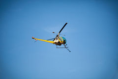 Crop sprayer duster helicopter, spraying mountains, fields and l Stock Images