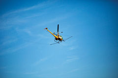Crop sprayer duster helicopter, spraying mountains, fields and l Stock Image