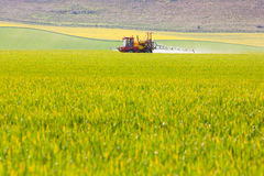 Crop sprayer in a field Royalty Free Stock Photo