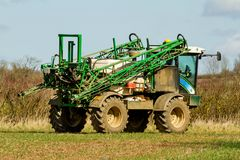 Crop sprayer parked and folded up in field Stock Image