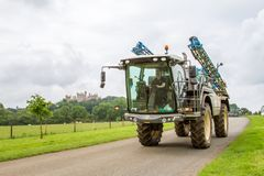 Crop sprayer on road with castle in background Stock Photography