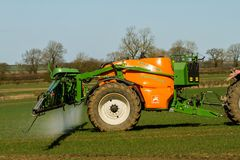 Crop spraying with amazone uk 3200 special sprayer. Crop spraying pestides with amazone uk 3200 special sprayer Royalty Free Stock Images