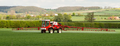 Crop Spraying in crop field Royalty Free Stock Image