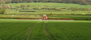 Crop Spraying in english field. Tractor crop spraying in bateman 3000 in english crop field Stock Image
