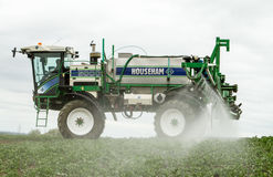 Crop Spraying in field. Tractor crop spraying in househam 5000 in english crop field Stock Images