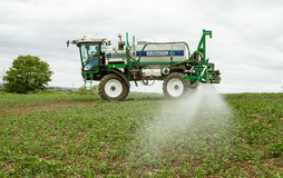 Crop Spraying in field. Tractor crop spraying in househam 5000 in english crop field Royalty Free Stock Photography