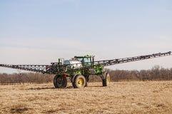 Crop spraying machinery,fertilize. A crop spraying machine spraying fertilizer on a farm field royalty free stock photography