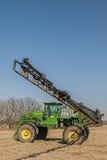 Crop spraying machinery,fertilize. A crop spraying machine spraying fertilizer on a farm field stock image