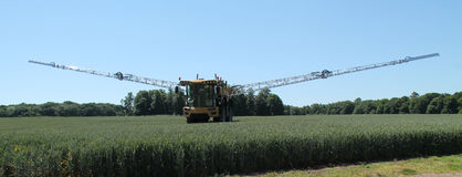 Crop Spraying Vehicle. A Large Agricultural Farm Crop Spraying Vehicle Stock Photos