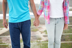 Crop of teenage girl and boy holding hands. Horizontal crop shot of teenage girl and boy holding hands royalty free stock images