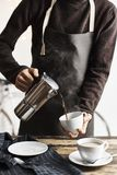 Crop bartender pouring coffee royalty free stock photo
