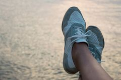 Crop view of female feet on seashore background. Personal point. Of view with relaxing concept and space for text royalty free stock images
