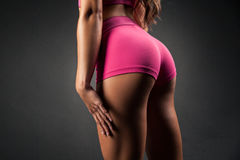 Crop view of female sportive buttocks Royalty Free Stock Photography
