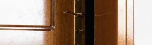 Crop view of half-open door. Security stock images