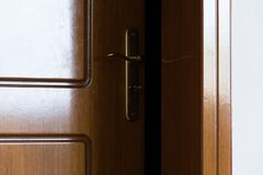 Crop view of half-open door. Security royalty free stock photography