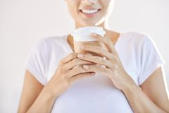 Crop woman holding cup of coffee to go royalty free stock image