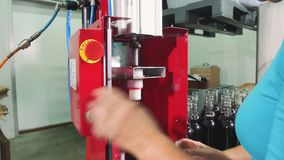 Process of corking wine bottles. Crop worker with help of machine corking glass bottles with new wine on viticulture production. Process of corking wine bottles stock footage