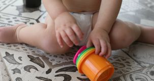 Baby boy plays educational toy crop stock video