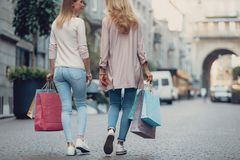 Middle-aged lady and her daughter walking on the street stock photos