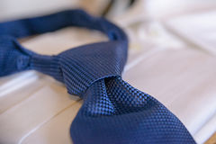 Cropped blue necktie on a white blurred background Royalty Free Stock Photo