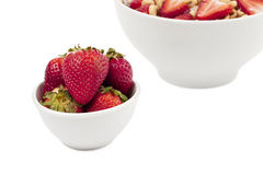 Cropped bowl of cereals and strawberry Stock Photos