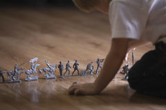 Cropped Boy With Toy Soldiers On Floor Royalty Free Stock Photo