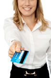 Cropped businesswoman displaying cash card Stock Photo