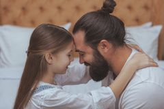 Father and daughter enjoying cozy day at home stock images