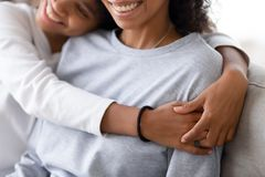 Cropped image of african daughter embracing mother royalty free stock images