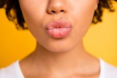 Cropped close up photo beautiful amazing she her dark skin lady send kisses perfect mouth plump lips naturally balm. Aesthetic look wear casual white t-shirt stock photo
