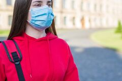 Free Cropped Close Up Photo Of Minded Pondering Pensive Teen Girl Wearing Casual Clothes Using Surgical Mask Outside Stock Images - 188902264