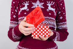 Cropped Close Up Photo Portrait Of Hands Holding Beautiful Little With Tied Bow Dotted Box In Hands Looking Aside Isolated On Royalty Free Stock Images