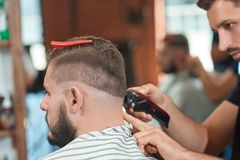 Young man at the barbershop stock images