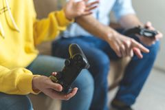 Two person playing at video games at home royalty free stock photo