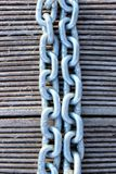 A Cropped Closeup Image Of A Linked Chain. Metal Chain Over Wooden Background. Abstract Textures Background stock photo