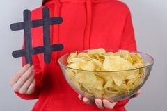 Cropped closeup photo of cheerful excited nice attractive people holding large big tasty yummy chips holding in hands isolated stock photos