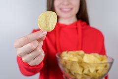 Cropped closeup photo of excited positive charming cheerful positive optimistic girl holding large big bowl gray. Background stock image