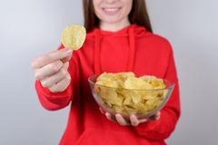 Cropped closeup photo of excited positive charming cheerful positive optimistic girl holding large big bowl gray. Background stock photography